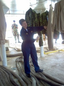Spraying my uniform with permethrin to protect against insects, on USNS Comfort, 2007
