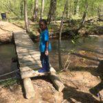 Maya crossing a creek