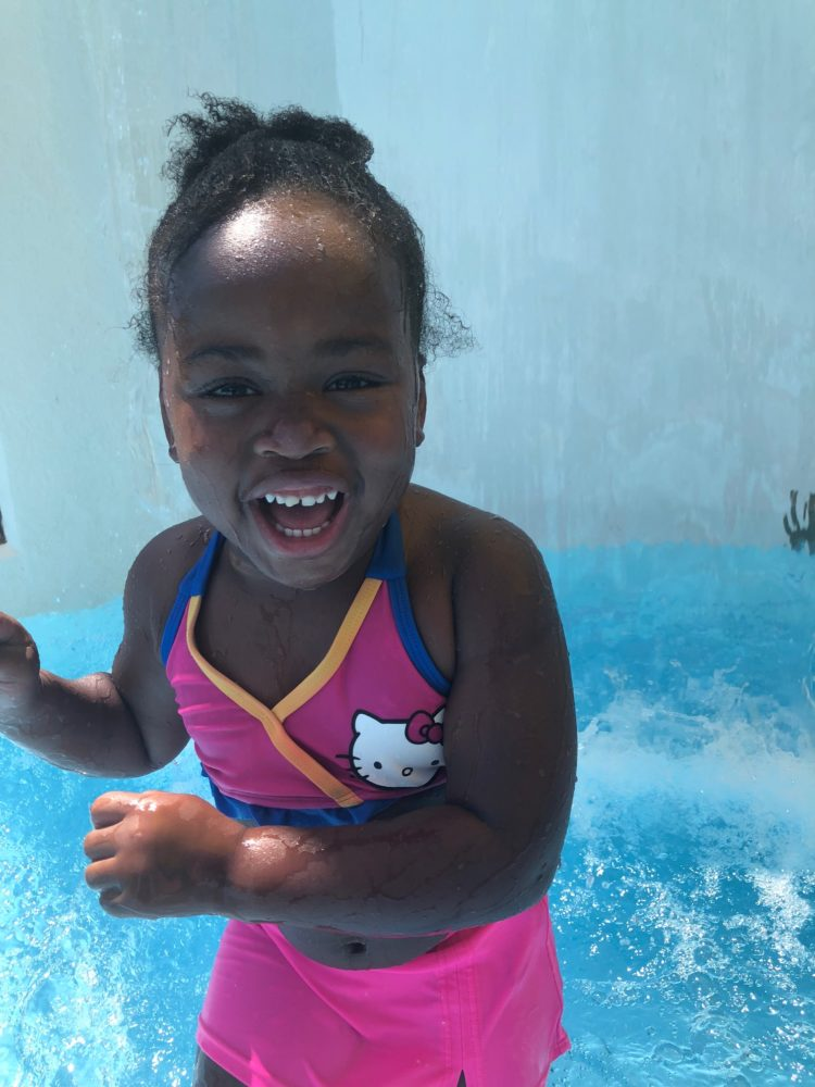 child laughing in pool